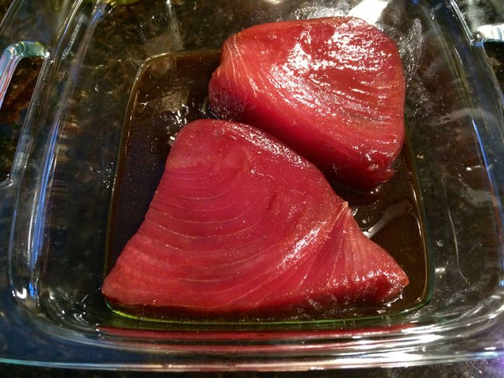 Tuna steaks marinating