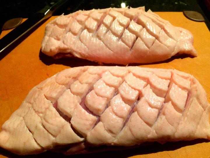 Scored duck breasts