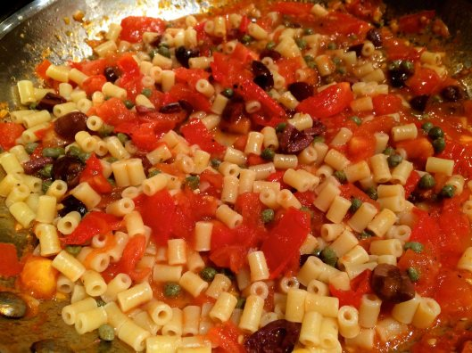 Sauce the cooked pasta before filling the peppers