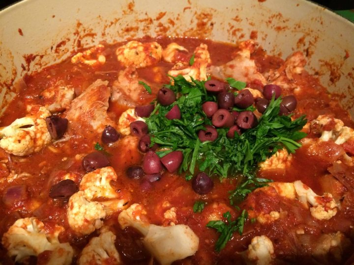 Adding the chicken, cauliflower, parsley, and olives